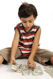 Cute little boy with money. Cute little boy plays with money stock photos