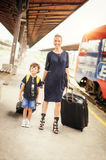 Cute little boy and mother on a railway station Royalty Free Stock Image