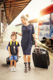 Cute little boy and mother on a railway station Royalty Free Stock Images
