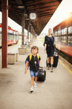 Cute little boy and mother on a railway station Stock Photos