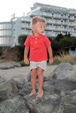 Cute Little Boy On The Rocks Royalty Free Stock Photography