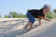 Cute Little Boy On The Sand Stock Image