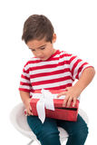 Cute little boy opening gift Stock Images