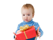 Cute little boy opens a gift box and rejoices, isolated on white Royalty Free Stock Image