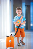 A cute little boy with orange suitcase Royalty Free Stock Photos