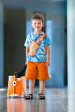 Cute little boy with orange suitcase Royalty Free Stock Photography