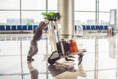 Cute little boy with orange suitcase at airport. The boy on the trolley and the airport Royalty Free Stock Photos