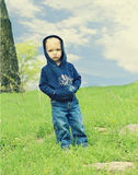 Cute little boy outdoors Stock Photos