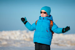 Cute little boy outdoors on cold winter day. Portrait of cute little boy outdoors standing on winter beach on cold winter day Stock Photography