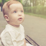 Cute little boy outdoors. At the day time Stock Photography