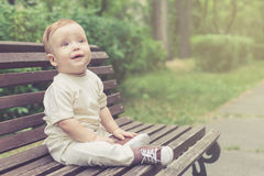 Cute little boy outdoors. At the day time Stock Image