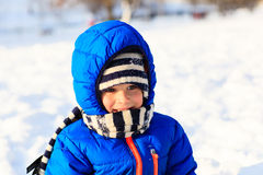 Cute little boy outdoors on winter snow. Day Royalty Free Stock Images