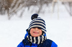 Cute little boy outdoors on winter snow day. Cute little boy outdoors on beautiful winter snow day Royalty Free Stock Image