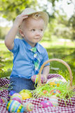 Cute Little Boy Outside Holding Easter Eggs Tips His Hat Stock Image