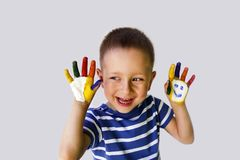 Cute little boy with painted hands. Cute little boy with painted hands royalty free stock images