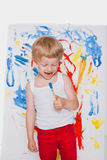Cute little boy painting with brush. School. Preschool. Education. Creativity Stock Image
