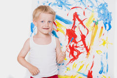 Cute little boy painting with brush. School. Preschool. Education. Creativity Royalty Free Stock Photography