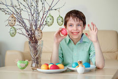 Cute little boy painting colorful Easter egg for hunt Royalty Free Stock Photography