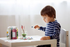 Cute little boy painting in his album Royalty Free Stock Image