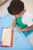 Cute little boy painting at table in classroom Royalty Free Stock Photography