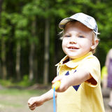Cute little boy in a park Stock Photo
