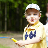 Cute little boy in a park Royalty Free Stock Image