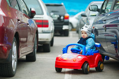 Cute little boy on parking Stock Photo