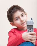 Cute little boy with phone Stock Image