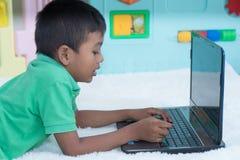 Cute little boy play computer stock photo