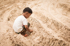 Cute little boy play sand Royalty Free Stock Image
