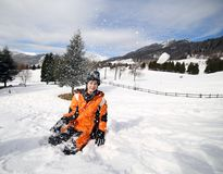 Cute little boy play with snow in the mountains Stock Image
