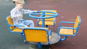 Cute little boy at playground area stock video footage