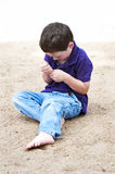 Cute little boy playing alone Royalty Free Stock Photography