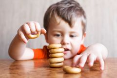 Cute little boy is playing with Bagel royalty free stock photography