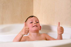 Cute little boy playing in the bath Royalty Free Stock Photos