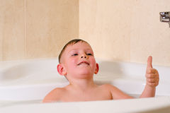 Cute little boy playing in the bath Royalty Free Stock Photo