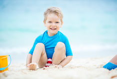 Cute little boy playing on the beach Royalty Free Stock Photos