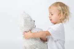 The cute little boy playing with a bear Royalty Free Stock Photos