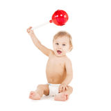 Cute little boy playing with big lollipop Stock Photo