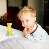 Cute little boy playing with blocks. Stock Photo