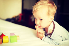 Cute little boy playing with blocks. Stock Image