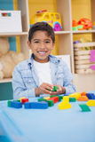 Cute little boy playing with building blocks Stock Image