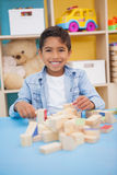 Cute little boy playing with building blocks Royalty Free Stock Photography