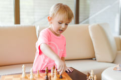 Cute little boy playing chess. Stock Images