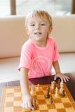 Cute little boy playing chess. Stock Image