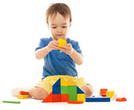 Cute little boy is playing with colorful blocks Royalty Free Stock Photos