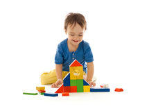 Cute little boy is playing with colorful building Stock Photos