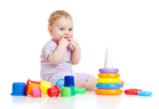 Cute little boy playing colorful toys Stock Photo