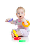 Cute little boy playing colorful toys. On white Stock Photo