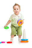 Cute little boy playing colorful toys Stock Images